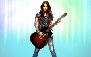 Майли Сайрус с гитарой