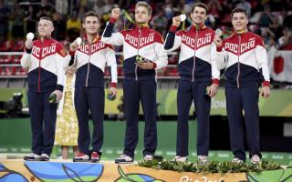 Мужская сборная России по спортивной гимнастике  завоевала серебряные олимпийские медали  в командном многоборье